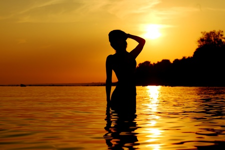 ocean woman in sunrise light photo