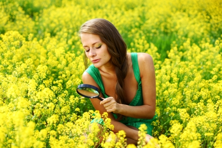 botanist woman in yellow flower field photo