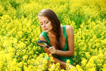 botanist: botanist woman in yellow flower field Stock Photo