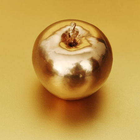 gold apple on gold background photo