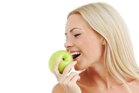 blond woman eat green apple on white Stock Photo - 8744121