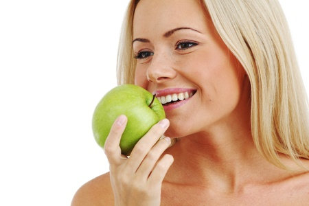 blond woman eat green apple on white Stock Photo - 8744156