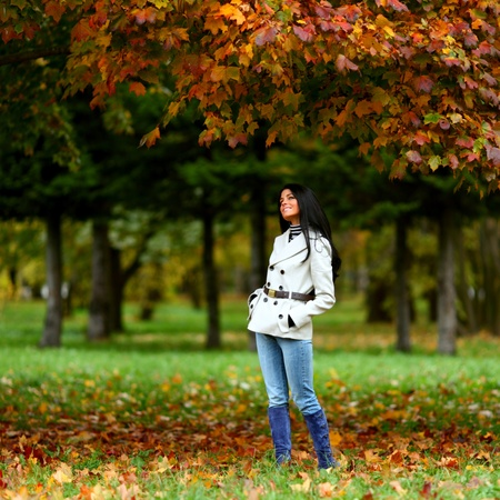 woman in yellow autumn park photo