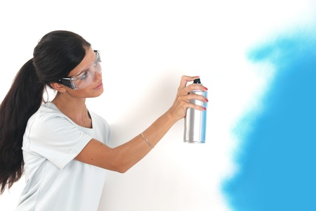gas can:  woman paints the wall of balon Stock Photo