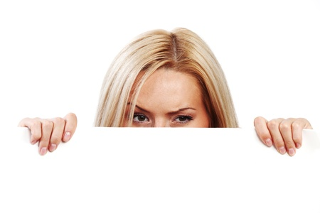 business woman hidden behind a white sheet of paper Stock Photo - 8743980