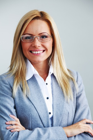 business woman in glasses on gray background Stock Photo - 8744285
