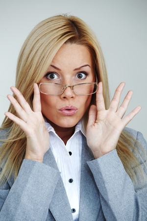 business woman in glasses on gray background Stock Photo - 8744261