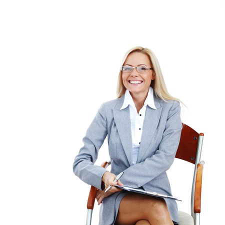 business woman in glasses on white background pen in hands photo