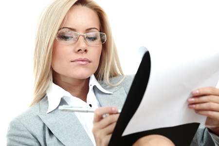 sexy secretary: business woman hold a folder of papers  and write