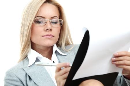 sexy secretary: mujer de negocios mantenga una carpeta de documentos y escribir Foto de archivo