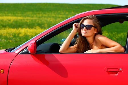 woman in red car get out window photo