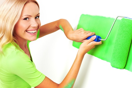 woman paints the wall brush Stock Photo - 8744223