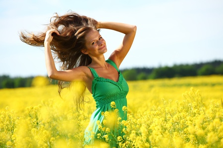 woman on oilseed field close portrait Stock Photo - 8744173