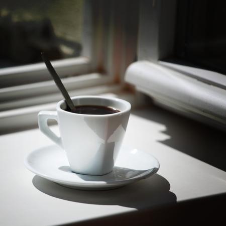 morning coffee on the window sill photo