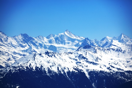 mountain range: top of mountains in blue sky Stock Photo