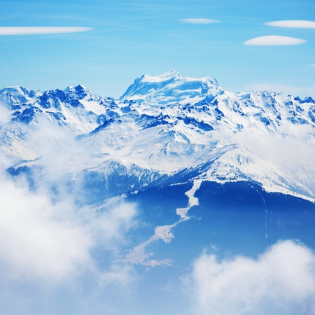 top of mountains in blue sky photo