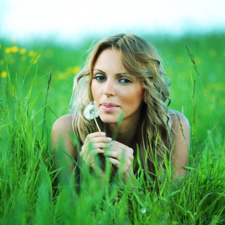 woman on the green grass happy and smile photo