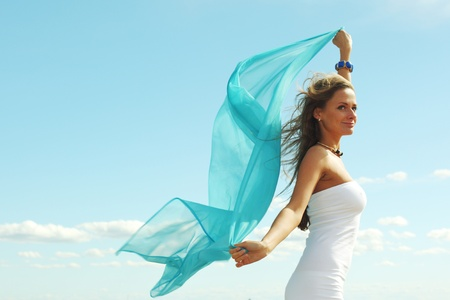 woman fly in the blue sky by fabric photo