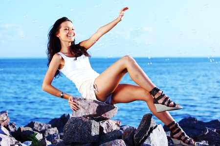 happy brunette hair woman sea on background photo