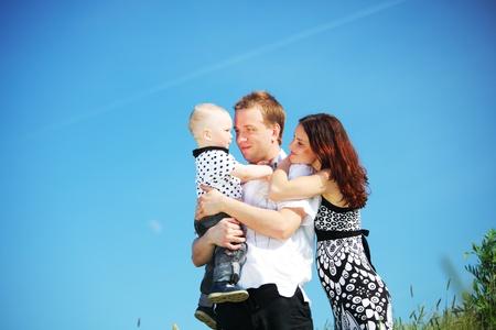 happy family blue sky on background photo