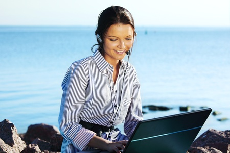 woman with laptop sea background Stock Photo - 8751390