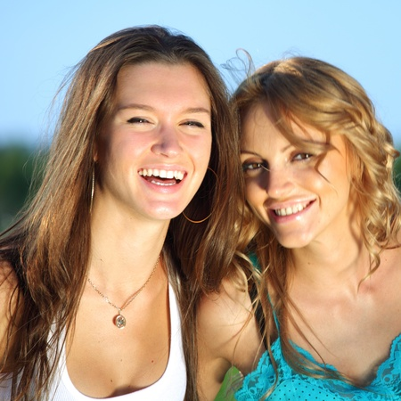 summer girlfriends in sun ligt happy and smile
