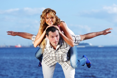 man and woman hug in the sky and sea on sea photo