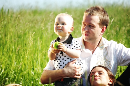 picnic of happy family on green grass Stock Photo - 8751695