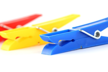 colored clothespins isolated on white background photo