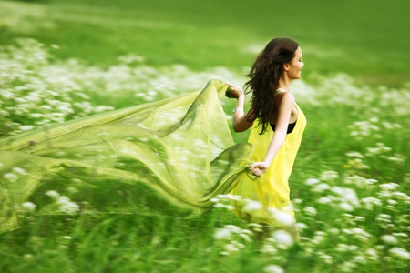 woman freedom: girl run by field fabric in hands fly behind like wings