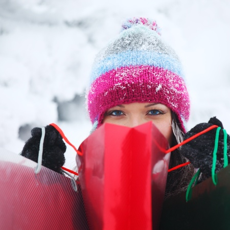 winter girl with gift bags on snow background Stock Photo - 8825704
