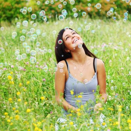 girlfriends on green grass field in soap bubbles Stock Photo - 8824690
