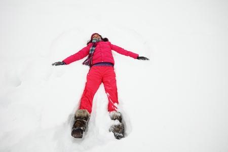 winter woman: winter woman lay on snow Stock Photo