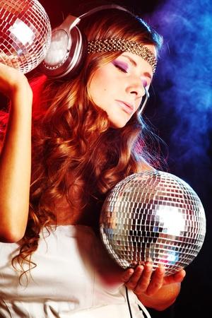 disco girl music in head phones Stock Photo