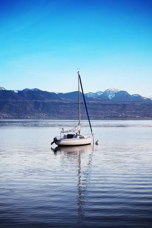 yacht in lake of geneva landscape on sunrise Stock Photo - 8824493