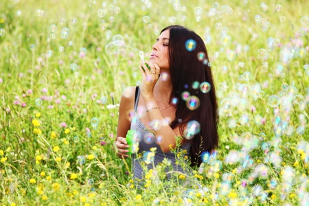 happy woman smile in green grass soap bubbles around Stock Photo - 8825125