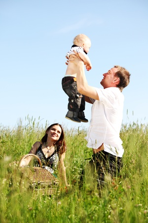 happy family in green grass photo