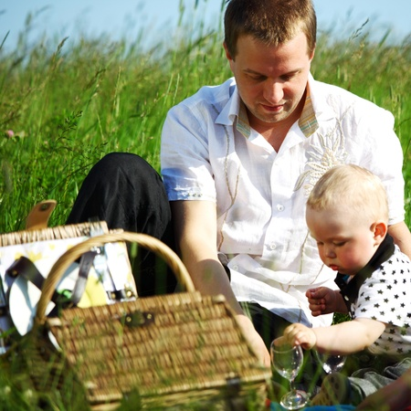 happy family on picnic in green grass Stock Photo - 8826806