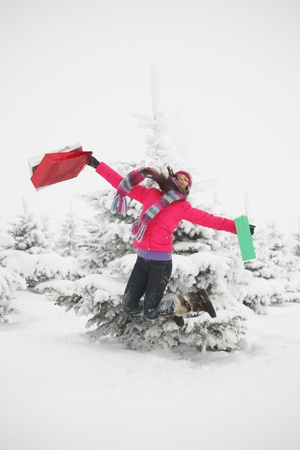 winter girl jump with gift on snow background photo
