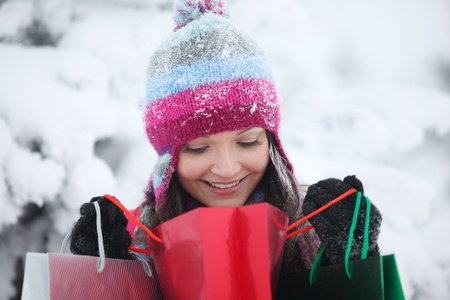 winter girl with gift bags on snow background Stock Photo - 8826506