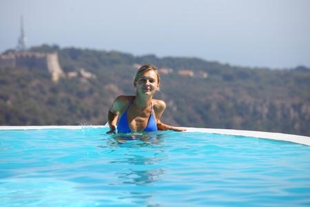 woman portrait in swimming pool photo