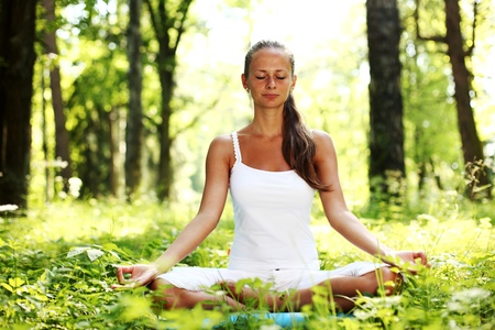 yoga woman on green grass in forest Stock Photo - 8917352