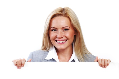business woman hidden behind a white sheet of paper Stock Photo - 8917416