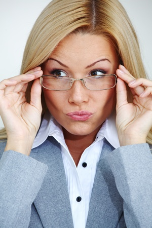 business woman in glasses on gray background Stock Photo - 8917538
