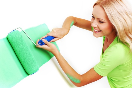 woman paints the wall brush Stock Photo - 8917509