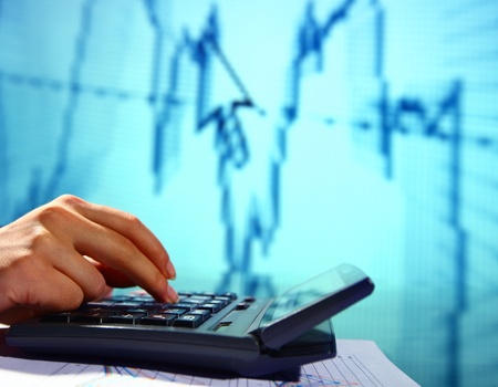 investing: businessman calculate investing growh business concept