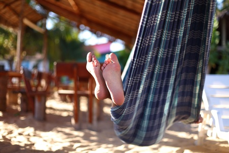 lounging: girl on vacation relax in hammock Stock Photo