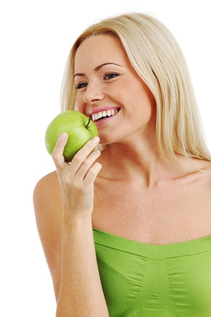 perfect teeth: blond woman eat green apple on white