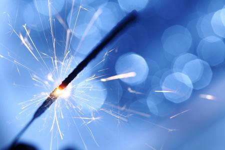 sparkler on blue bokeh background macro close up Stock Photo - 9005684