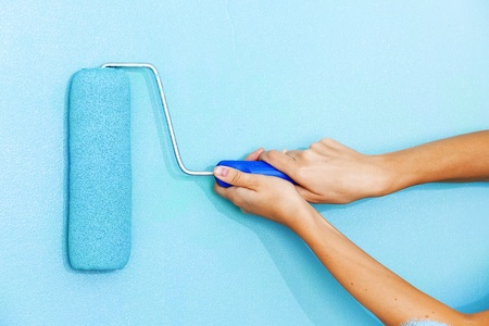 paint tool: woman paints the wall roller